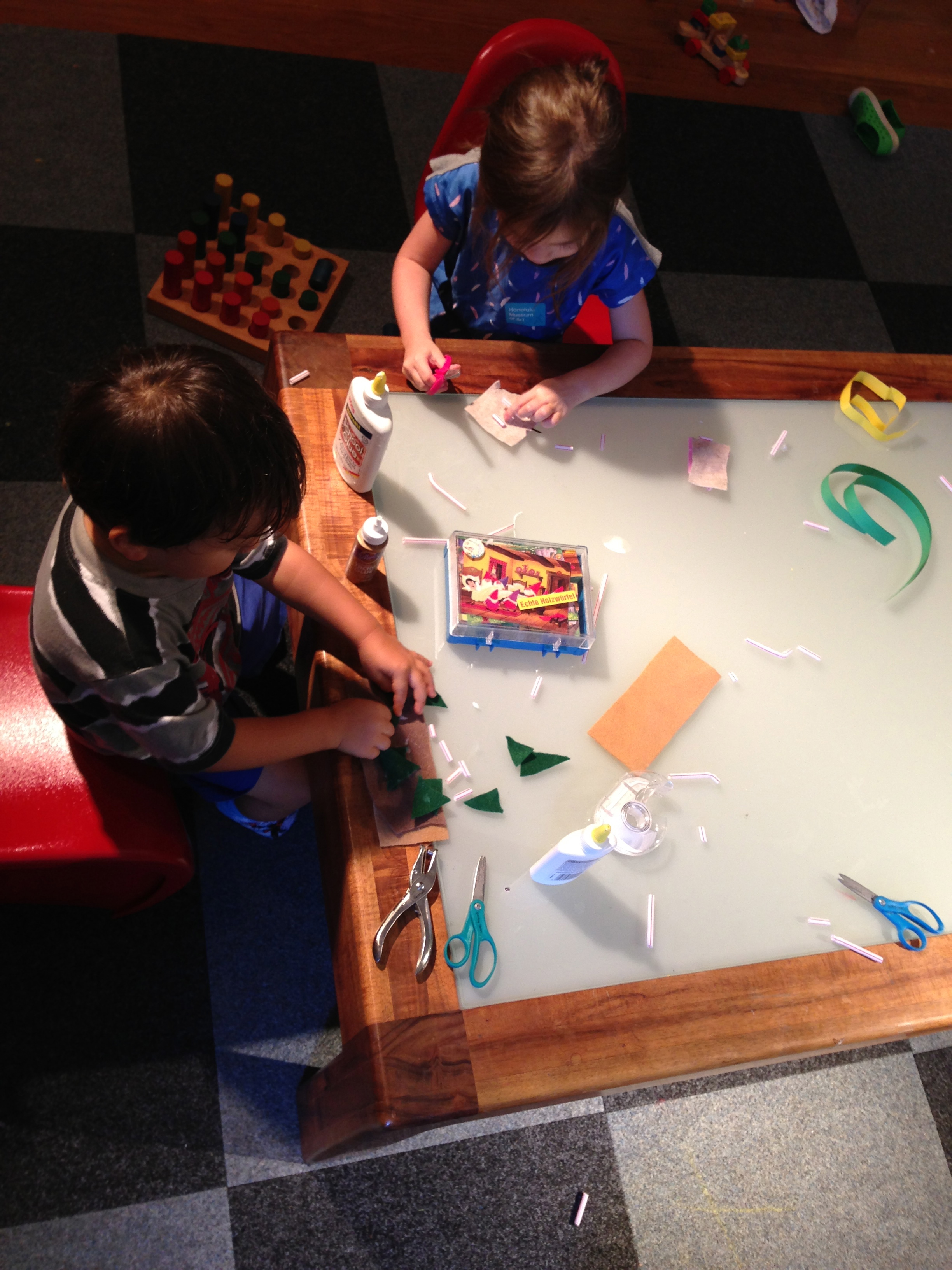 Making monsters and sandwiches with felt, straws and glue.